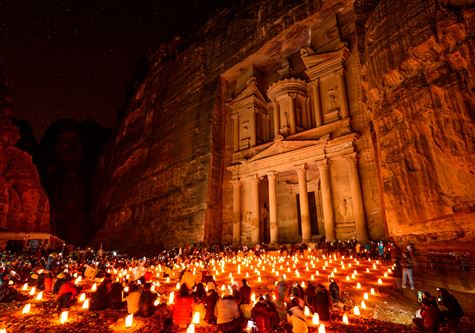 Al Khazneh in the ancient city of Petra, Jordan at night. It is known as The Treasury. Petra has led to its designation as a UNESCO World Heritage Site - Cox & Kings Treasures of Jordan Solo Tour