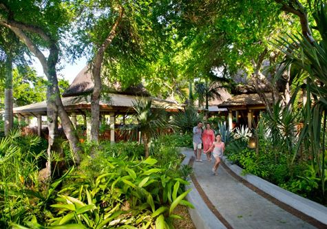 A family strolling through the gardens at Club Med Albion Mauritius resort