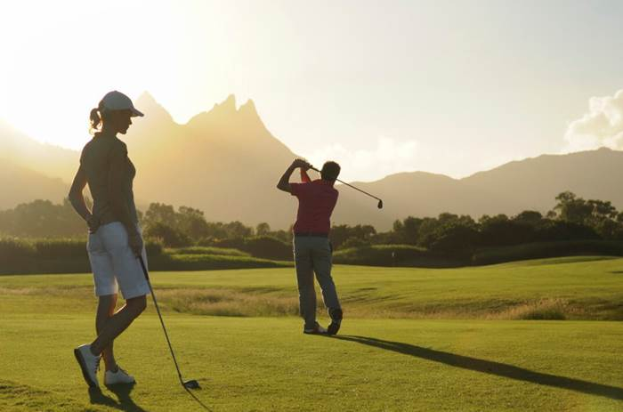 Two people playing golf at the Club Med Albion Mauritius resort