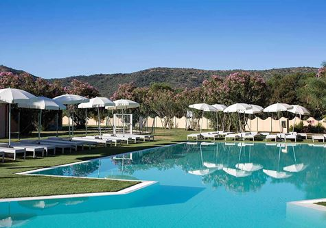 A stunning view over the pool and gardens at Neilson Baia De Mori Beachclub in Sardinia