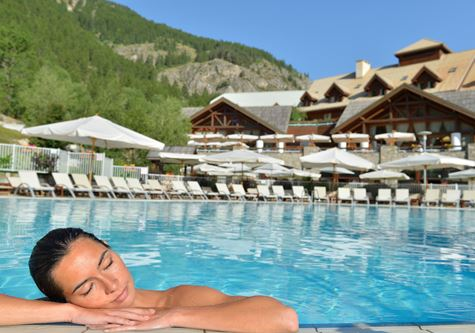 A woman enjoying the outdoor pool at the Club Med Serre-Chevalier in summer