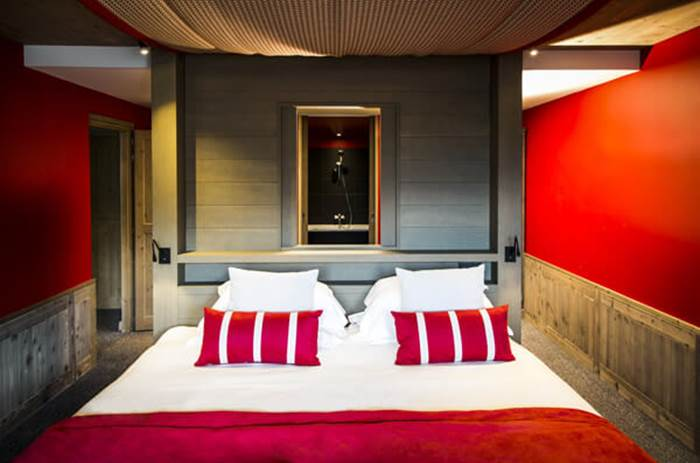 A double bed at the Club Med Valmorel Chalets