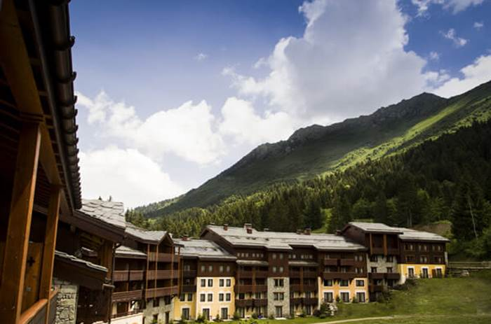 Exterior view of the Club Med Valmorel Chalets in summer