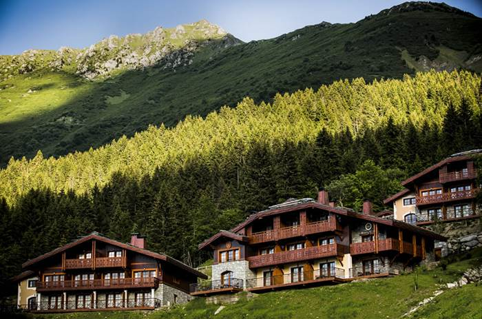 An uphill view of the Club Med Valmorel Chalets during summer