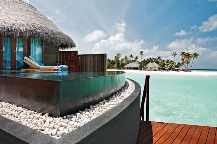 An infinity pool overlooking the beach at Constance Halaveli resort in the Maldives
