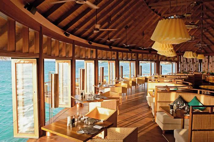 Dining restaurant within a villa at Kuoni Constance Halaveli