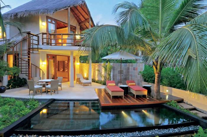 The exterior of a villa at Kuoni Constance Halaveli in the Maldives