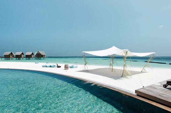 Overwater loungers at constance moofushi maldives resort