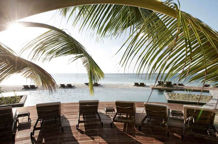 Decking by the pool at constance moofushi maldives resort