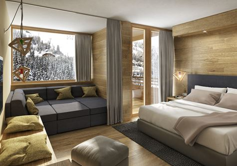 A view of the Neilson Chalet Cristallo luxury bedroom with a view of the snowy mountains