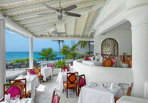 A restaurant at crystal cove resort by elegant hotels in Barbados
