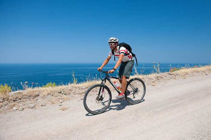 Cyclist by the sea at Mark Warner Lemnos Beach Resort in Greece