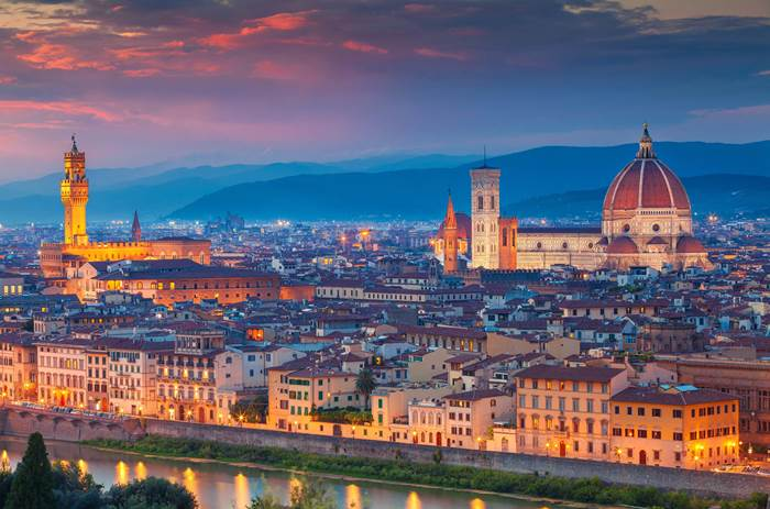 Tauck Classic Italy - Florence. Cityscape image of Florence, Italy during dramatic sunset
