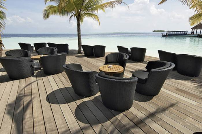 Lounge chairs on the decking at the  Kuoni Komandoo Island and Spa in the Maldives