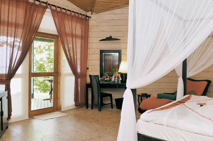 A four poster bed at the Kuoni Komandoo Island and Spa in the Maldives
