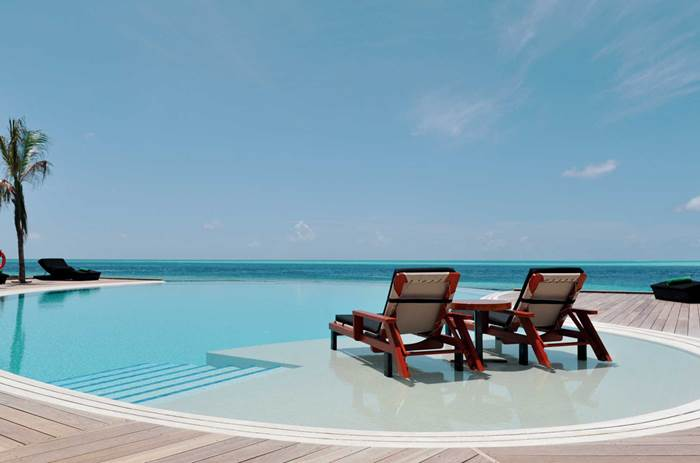 Two sun loungers in the sun at the resort at Kuoni Komandoo Island and Spa in the Maldives