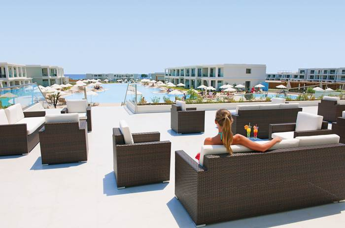 Guest relaxing at the outdoor lounge at Mark Warner Levante Beach Club