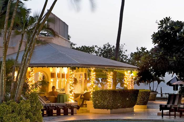 A bar area lit up by lights at Mango Bay resort in Barbados