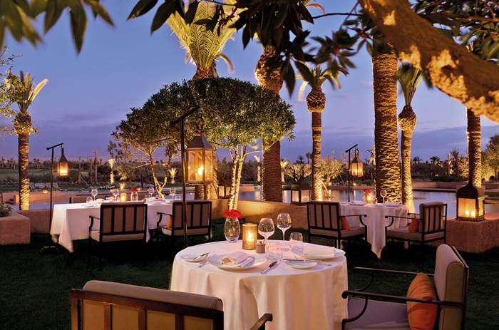 A candlelit dinner at night at the Beachcomber Royal Palm