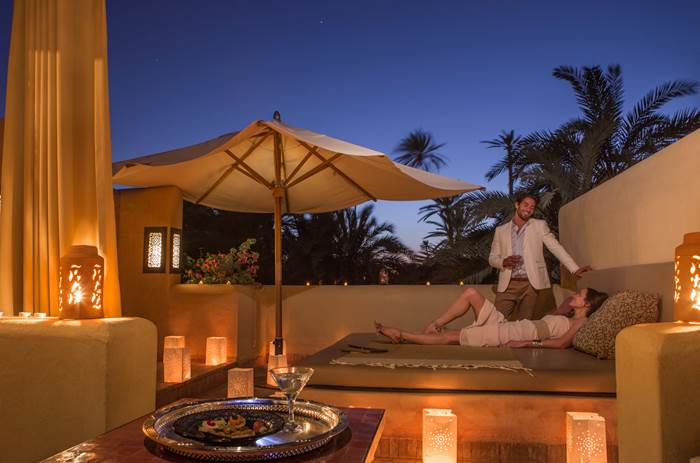 A couple enjoying their private balcony at Club Med Marrakech resort in Morrocco