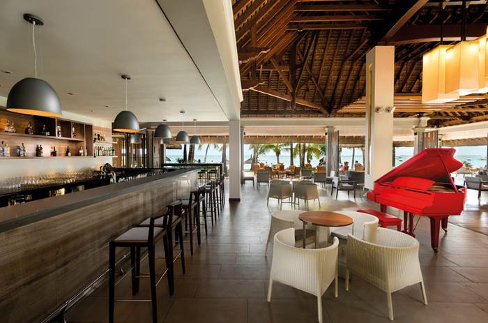 An indoor bar and restaurant at Beachcomber Paradis Hotel & Golf Club in Mauritius