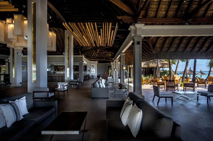 An indoor bar on the beach at Beachcomber Paradis Hotel & Golf Club in Mauritius
