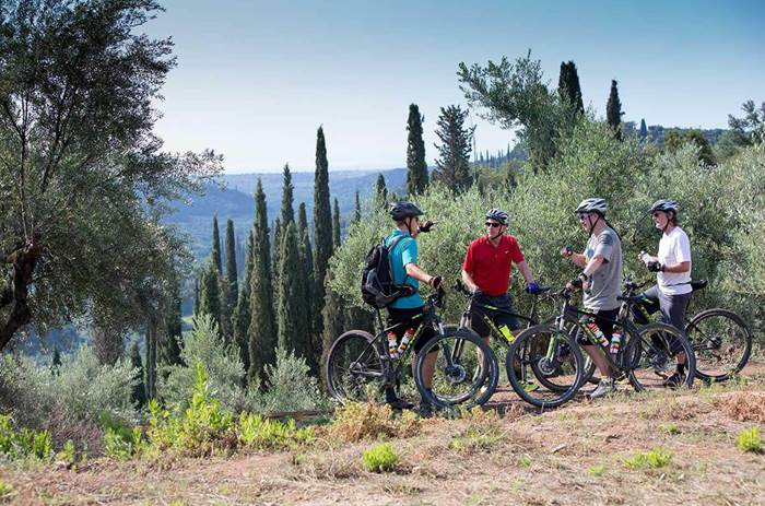 A group of men on bikes in the hills near Neilson Buca Beach resort in Greece