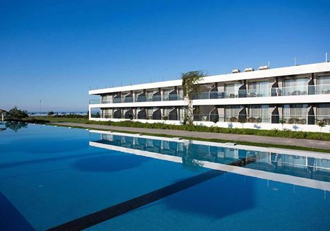 An landscape view of the main building at Neilson Buca beach resort in Greece