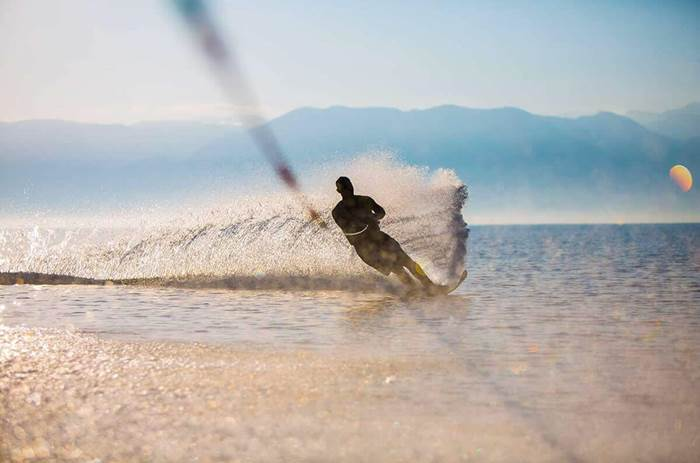 A man waterskiing in Greece at Neilsons Buca Beach resort