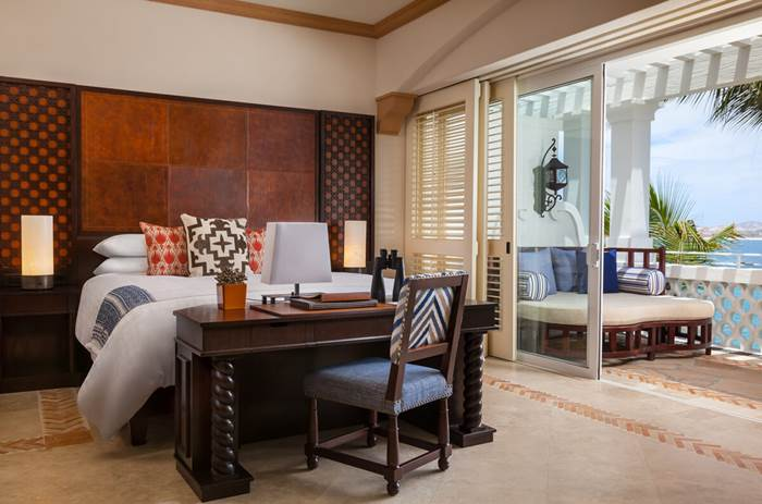 A double bed with the doors wide open at the the One and Only Palmilla Hotel