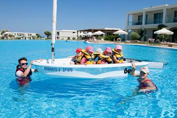 Children in sailing boat at Mark Warner Levante Beach Resort in Rhodes