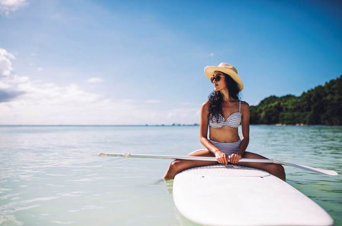 Woman paddleboarding at Club Med Seychelles
