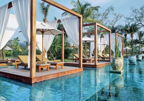 Overwater beds at the pool at the Kuoni Sarojin hotel in Thailand